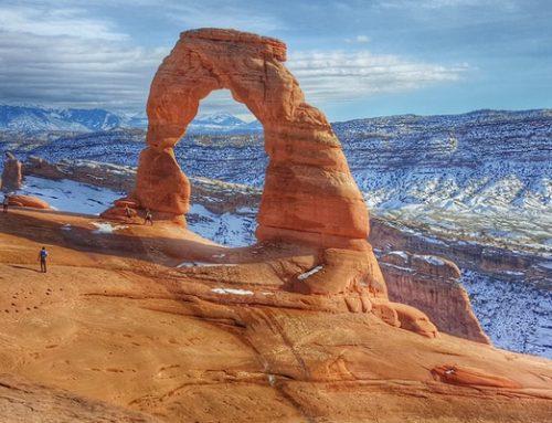 Towering red rocks in Moab, Utah: Canyoneering and rock climbing soars